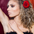 Beautiful fashionable woman with red rose - Stock Photo
