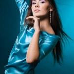 Fashionable woman on blue background — Stock Photo