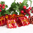 gift boxes with pinecone and european holly — Stock Photo