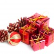 Stock Photo: Festive gift boxes with cone isolated on white background
