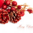 Christmas pinecone with european holly — Stock Photo