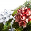 Branch of Christmas tree with bow — Stock Photo #4495838