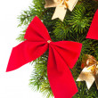 Branch of Christmas tree with ribbon — Stock Photo
