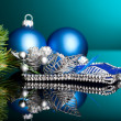 Branch of Christmas tree with festive ball — Stock Photo