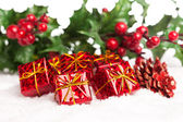 Gift boxes with pinecone and european holly — Stok fotoğraf