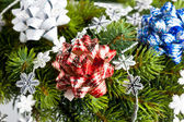 Branch of Christmas tree with bow — Стоковое фото