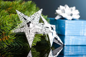 Branch of Christmas tree with gift box and star — Stockfoto