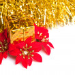 Christmas gift boxes with red poinsettia — Stock Photo