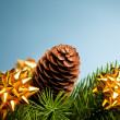 Branch of Christmas tree with bow - Stock Photo