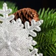 Branch of Christmas tree with snowflake - Stock fotografie