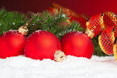 Branch of Christmas tree with festive ball — Стоковое фото