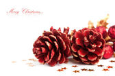 Christmas pinecone with european holly — Stok fotoğraf