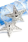 Christmas stars with festive ribbon — Stock Photo