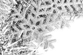 Christmas snowflake with festive garland — Stock fotografie