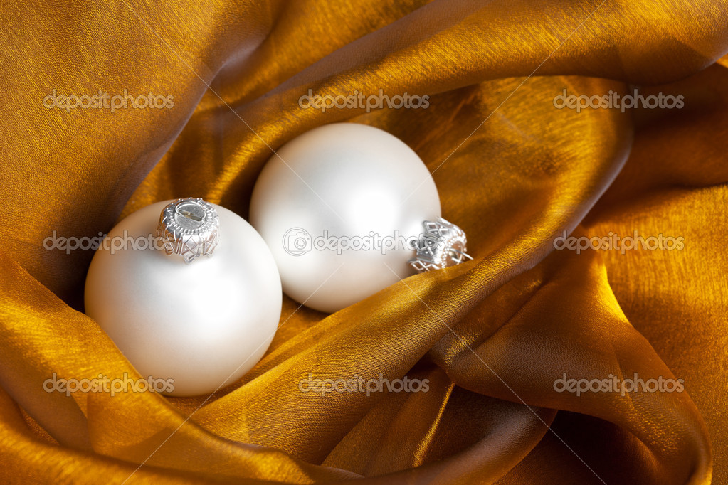 Christmas decoration on golden silk  Stock Photo #4504902