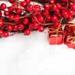 Gift boxes with european holly — Stock Photo #4574494