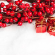 Gift boxes with european holly — Stock Photo