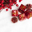 Gift boxes with european holly — Stock Photo #4574500