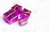 Many gift boxes in snow — Stock Photo