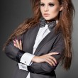 Elegant fashionable woman with bow-tie — Stock Photo