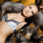 Beautiful woman in a fur coat — Stock Photo