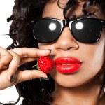 Mulatto girl with fresh strawberry — Stock Photo #5104647