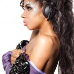 Mulatto girl DJ listens music with headphones — Stock Photo #5104674