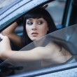 Beautiful fashionable woman in the car - Stok fotoraf