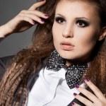 Elegant fashionable woman with bow-tie — Stock Photo