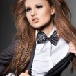 Elegant fashionable woman with bow-tie — Stock Photo #5104775