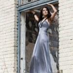 Fashionable woman at the grunge window — Stock Photo