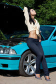Beautiful woman near the car — Stock Photo