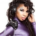 Mulatto girl DJ listens music with headphones — Stock Photo #5240554