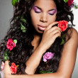 Elegant mulatto girl with circlet of flowers - Photo