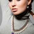 Elegant fashionable woman with violet visage — Stock Photo