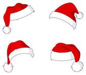 Santa hoeden — Stockvector
