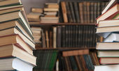 Open books in a library — Stock Photo