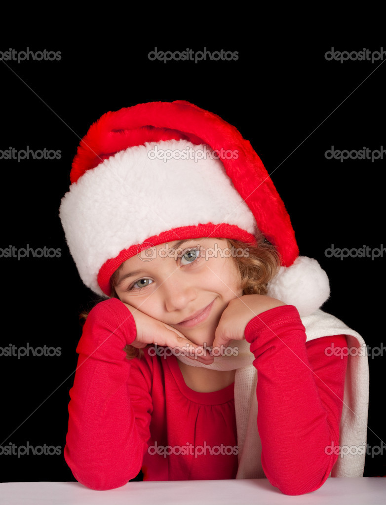 Cute girl in Christmas hat, dreaming  — Stock Photo #4401977