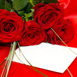 Red roses and invitation card - Stok fotoğraf