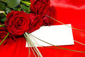 Red roses and invitation card — Stok fotoğraf