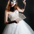 Girl with fan and mask in white dress — Photo #4678435