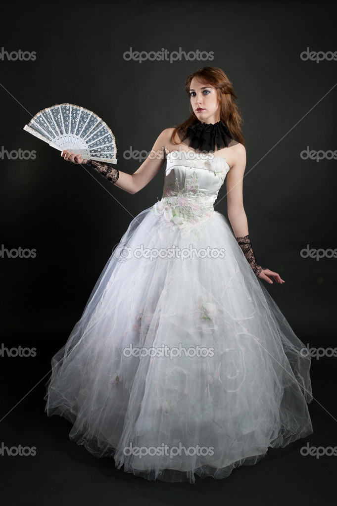 Girl with fan in white dress on black background — Photo #4737992