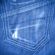 Stock Photo: Shabby jeans pocket with tear