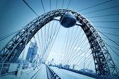 Vivid red suspension bridge — Stock Photo