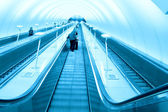 Cool hallway with fast escalator — Stock Photo