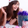 Royalty-Free Stock Photo: Attractive young girl with christmas vivid presents