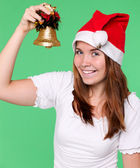 Attractive young girl with christmas handbell — Stock Photo