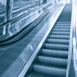 Perspective view to moving escalator in metro station - Stock Photo