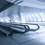 Perspective view to moving staircase in metro station — Stock Photo
