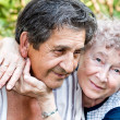 Stock Photo: Actual gladness of elderly hugging